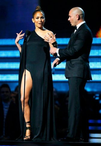 Presenters Lopez and Pitbull speak on stage at the 55th annual Grammy Awards in Los Angeles